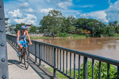 A man by bicycle in  Iron Bridge at Chiang Mai Royalty Free Stock Photos