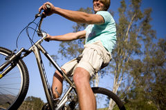Man on bicycle, low angle view Royalty Free Stock Images