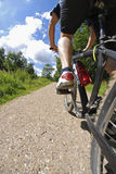 Man on bicycle low section low angle view Stock Photography
