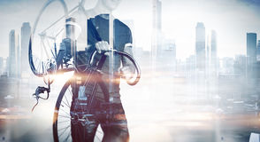 Man with a bicycle on modern background Royalty Free Stock Images