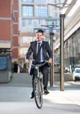 Man on a bicycle on modern city background Royalty Free Stock Image