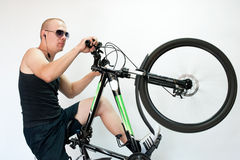 A man with a bicycle in motion. Man performs a trick with a bicycle Stock Photo