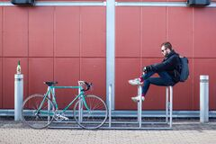 Man on bicycle rack Stock Images