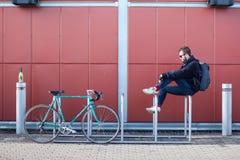 Man on bicycle rack