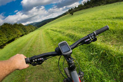 Man with bicycle riding country road Stock Photography