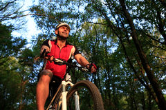 Man with bicycle riding country road Royalty Free Stock Photo