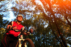Man with bicycle riding country road Royalty Free Stock Photos