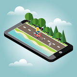 Man on bicycle on the road near the beach and forest. Mobile geo tracking Royalty Free Stock Photo