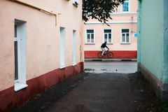 Man with bicycle on the street. Man with bicycle run through village street stock images