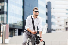 Man with bicycle and smartphone on city street Royalty Free Stock Photo