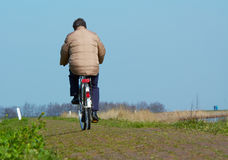Man on bicycle in spring Royalty Free Stock Photo