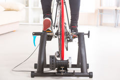 Man on bicycle trainer Stock Photos