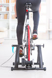 Man on bicycle trainer Stock Photography