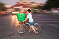 Man on bicycle transports large basket in Bangkok Royalty Free Stock Photography