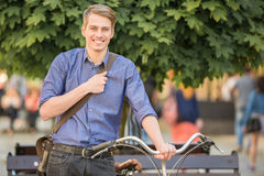 Man with bicycle Stock Images