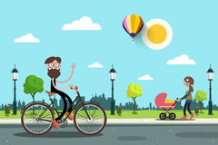 Man on Bicycle and Young Woman with Baby Carriage Royalty Free Stock Photography