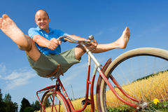 Man bicycling Stock Image
