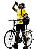 Man bicycling  mountain bike drinking silhouette. One caucasian man exercising bicycle mountain bike drinking   on white background Royalty Free Stock Image