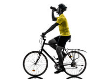 Man bicycling  mountain bike drinking silhouette. One caucasian man exercising bicycle mountain bike drinking   on white background Royalty Free Stock Photos