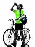 Man bicycling  mountain bike drinking silhouette. One  man exercising bicycle mountain bike drinking on white background Stock Photography