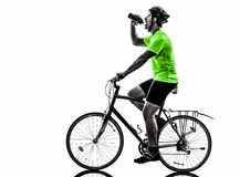Man bicycling  mountain bike drinking silhouette. One  man exercising bicycle mountain bike drinking on white background Stock Photo