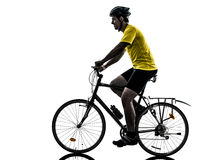 Man bicycling  mountain bike silhouette. One caucasian man exercising bicycle mountain bike on white background Stock Photos