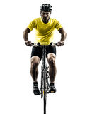 Man bicycling  mountain bike silhouette. One caucasian man exercising bicycle mountain bike   on white background Stock Image