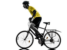 Man bicycling  mountain bike silhouette. One caucasian man exercising bicycle mountain bike   on white background Royalty Free Stock Photography