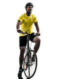 Man bicycling  mountain bike silhouette. One caucasian man exercising bicycle mountain bike  on white background Stock Images