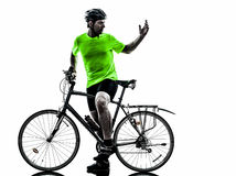 Man bicycling  mountain bike silhouette. One  man exercising bicycle mountain bike on white background Stock Photos