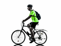 Man bicycling  mountain bike silhouette. One  man exercising bicycle mountain bike on white background Royalty Free Stock Images
