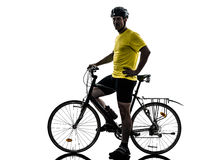 Man bicycling  mountain bike standing silhouette. One caucasian man exercising bicycle mountain bike standing on white background Royalty Free Stock Image