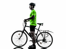 Man bicycling  mountain bike standing silhouette. One  man exercising bicycle mountain bike standing on white background Stock Photography