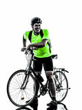 Man bicycling  mountain bike standing silhouette Stock Images