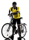 Man bicycling  mountain bike standing silhouette Royalty Free Stock Images