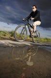 Man bicycling Stock Image