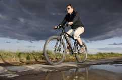 Man bicycling Royalty Free Stock Photo