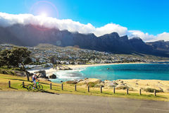 Man on bicykle enjying view at Cape Town Camps Bay on sunny warm day Royalty Free Stock Image