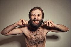 The man with a big beard and mustaches. Portrait of the young man with a beard and mustaches Stock Photos