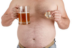Man with a big belly with beer in hand. Isolated on white background Stock Photos