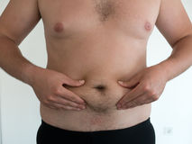 Man with big belly on white background Stock Photo