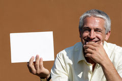Man with big blank card Royalty Free Stock Photography