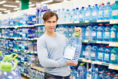 Man with big bottle drinking water Royalty Free Stock Photos