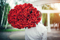 Man with big bouquet of roses outdoor royalty free stock photography