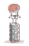 Man with big brain on stack of books Royalty Free Stock Photography