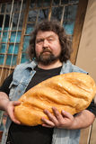 Man with big bread Royalty Free Stock Photo