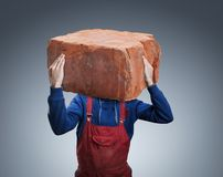 Man with a big brick Royalty Free Stock Images