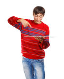 Man with big card. Smiling man in red striped sweater isolated on white background indicating plane Royalty Free Stock Image