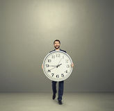 Man with big clock going forward Royalty Free Stock Images