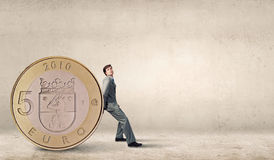 Man and big coin Stock Photo